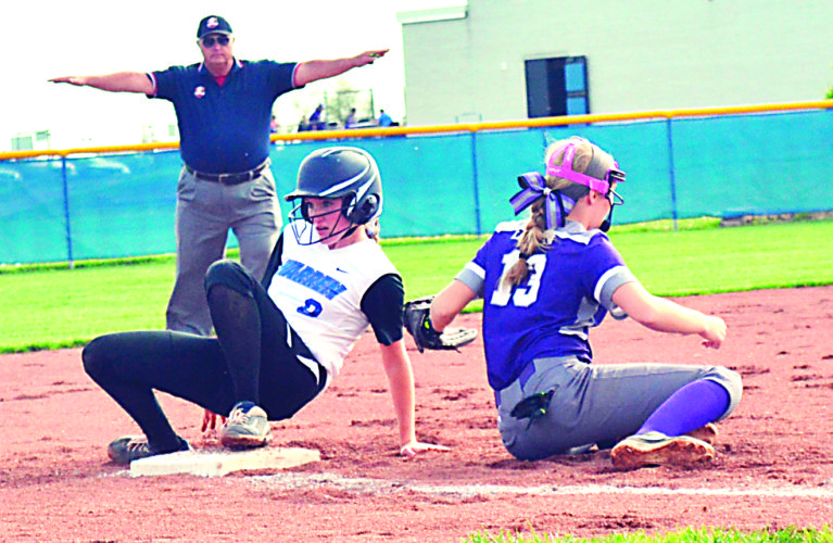 RON JOHNSTON The Marietta Times Warren's Olivia Shutts, left, is safe as Logan third baseman Payton Frasure tries to apply a tag during SEOAL softball action Friday. The Warriors hung on to win, 4-3.