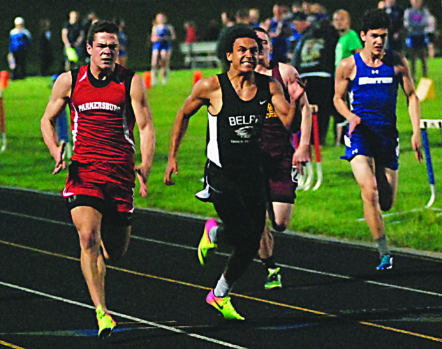 JORDAN HOLLAND The Marietta Times Parkersburg's Logan Wooddell, left, and Belpre's Tojzae Reams, right, finish neck-and-neck in the 100 meter dash during Friday's Erickson All-Sports Invitational in Parkersburg.