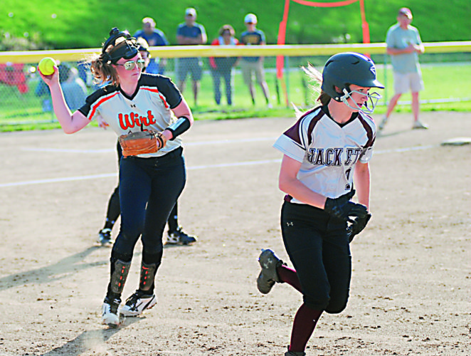 JAY W. BENNETT The Marietta Times Wirt County pitcher Jessi Lockhart, who had a no-hitter through 5 2-3 innings, fields a bunt by Williamstown's Keely Alsup and makes the throw to first base during the fifth inning of the Tigers' 5-1 win on Friday evening.