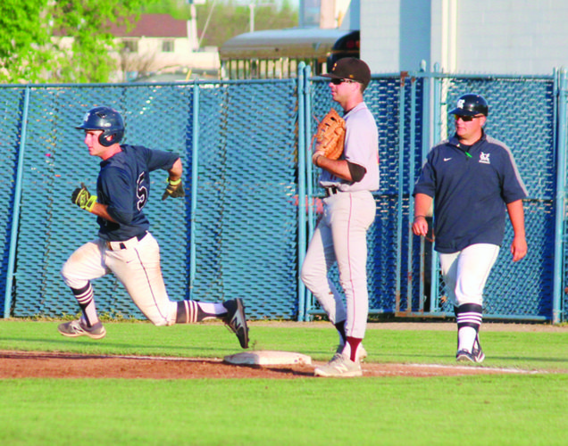 Photo courtesy of France Moise Marietta College's Chris Petrucci, left, rounds first base during a college baseball game against Oberlin College Wednesday at Don Schaly Stadium.