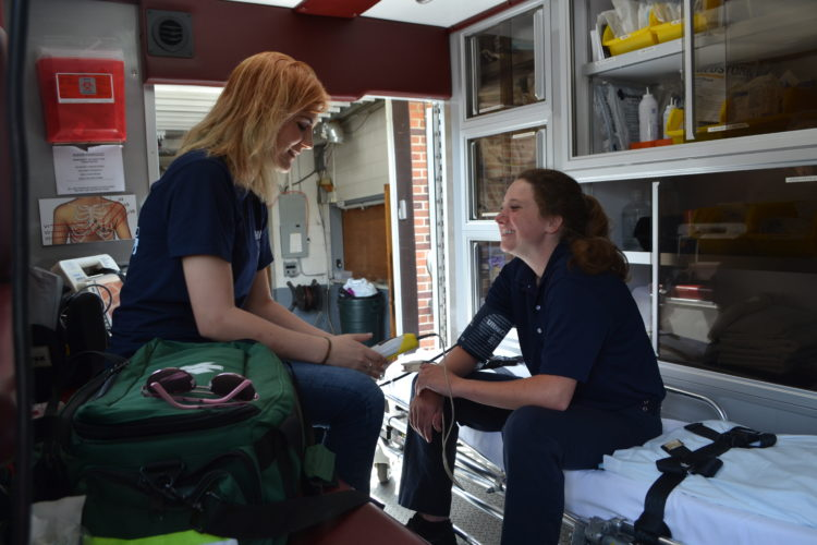 ERIN O'NEILL  The Marietta Times Kate Davis, a paramedic with the Reno Volunteer Fire Department, left, works Wednesday with Emma Booth, right, a senior at Marietta High School who is working on completing her course to become an EMT.