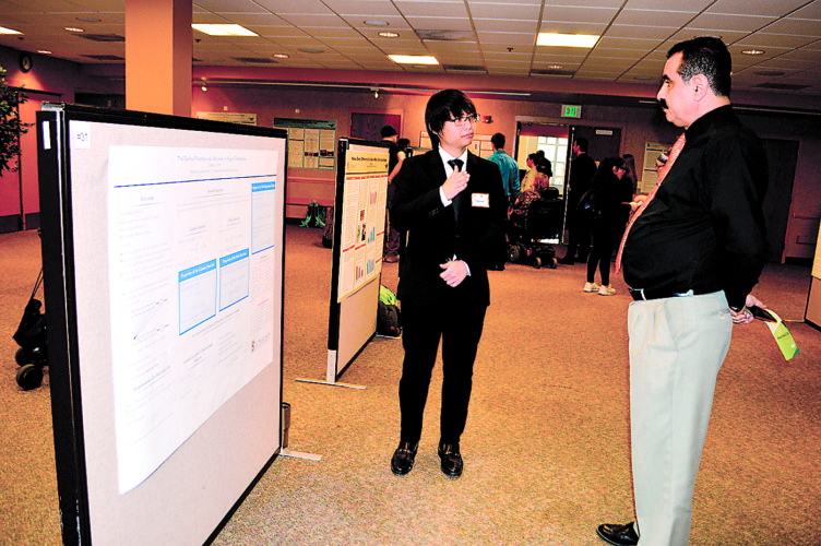 Photo by Jenny Kirk SMSU senior Samson Chen, left, answers questions regarding his research project — The Gamma Function and Volumes in Higher Dimensions — during the 2016 Undergraduate Research Conference on Wednesday.