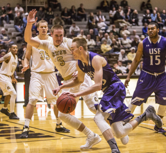 Independent file photo SMSU's Mitch Weg (5) plays defense against a University of Sioux Falls player during their game on Tuesday night.