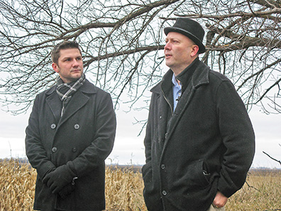 "Photo by Deb Gau On Friday, Alex Petersen and Marty Seifert were among the visitors to the former site of a farmhouse in rural Clements where five people were murdered in 1917. Petersen, who farms the property now, learned that Seifert was writing a novel based on the story. The book, titled ""Sundown at Sunrise,"" will be released this month."