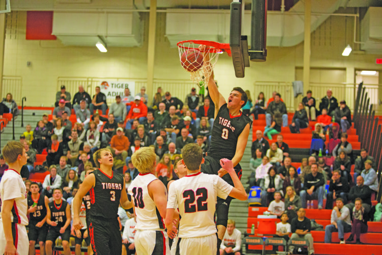 Photo by Sam Thiel  Marshall's Weston Baker Magrath slams the basketball during the Tigers' game against Redwood Valley on Tuesday night. Marshall won 82-56.