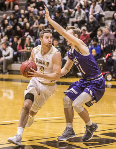SMSU senior guard Drew Osmundson, left, drives to the basket with a defender guarding during the Mustangs' game against USF on Nov. 29.