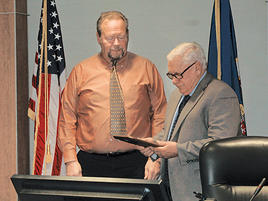 Photo by Deb Gau Lyon County Commissioner Rodney Stensrud, right, was honored during a short ceremony Thursday after serving on the board for the last 10 years.