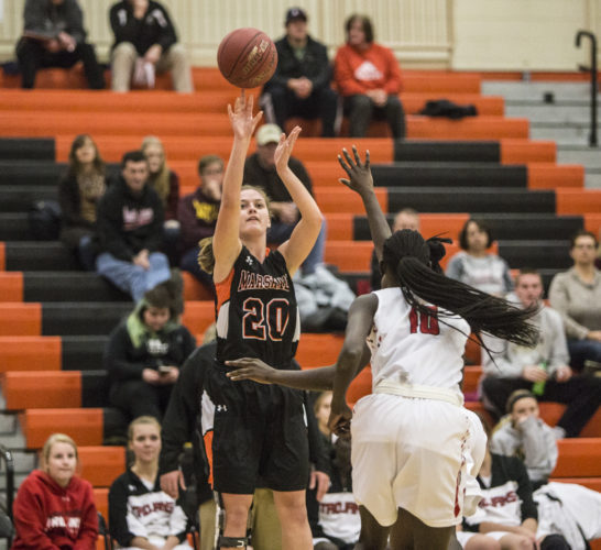 Photo by Sam Thiel  Marshall's Whitney Schwartz shoots over a Worthington defender during the Tigers' game against the Worthington Trojans on Thursday night.