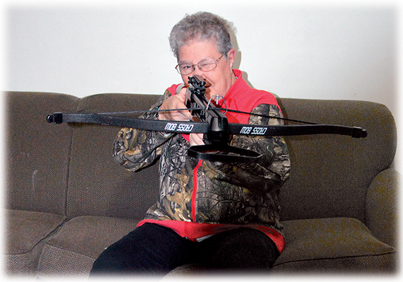 Photo by Jenny Kirk Mavis Verschelde, a passionate and outdoor-loving woman, demonstrates how to take aim with her crossbow.