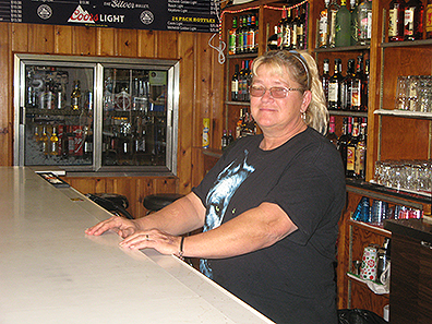 Photo by Deb Gau Sandy Rebstock bought Vesta's former municipal liquor store, and officially took ownership last month. Rebstock, who has roots in the Vesta area, said the connection was one factor in her decision to buy the business.