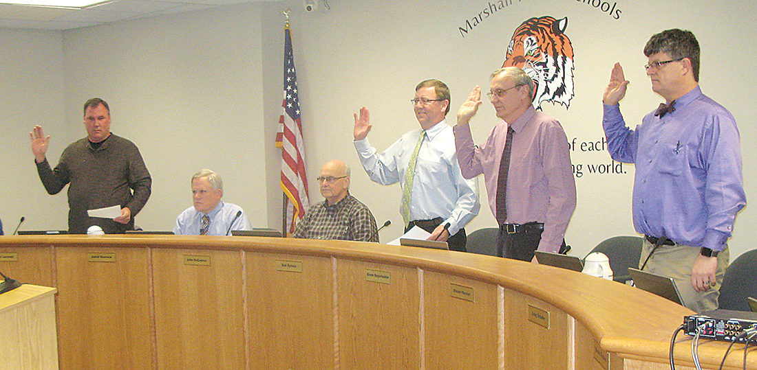 Photo by Deb Gau Members of the Marshall City Council were sworn into office Tuesday evening. From left to right, council member James Lozinski, Mayor Bob Byrnes, and council members Glenn Bayerkohler and Steven Meister were elected in November.