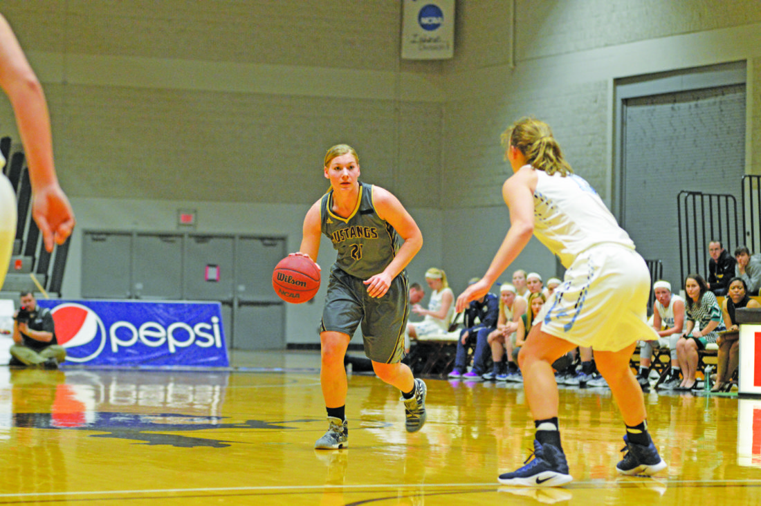 Independent file photo  SMSU's Sarah Buysse looks to drive past a Peacock defender in the second half on Saturday.