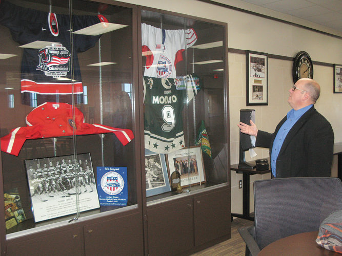 Photo by Deb Gau One of the unique features of the Red Baron Arena and Expo is a display of memorabilia on loan from the U.S. Hockey Hall of Fame Museum in Eveleth. Darin Rahm, director of the Marshall Convention and Visitors Bureau, talked about the items on display earlier this week.