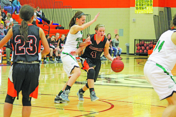 Photo by Brennen Rupp  Marshall's Maddie Marks drives around a Hill-Murray defender Saturday in the first half. Marshall lost 60-56.