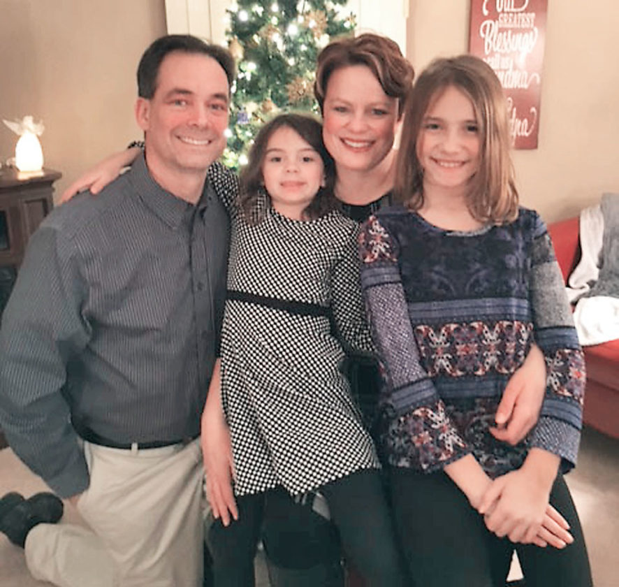 Submitted photo Rick and Heather Purrington have two children, Juliann, 10, and Brooklyn, 6, whom they are happy to raise in Marshall, the small town they, themselves grew up in. Rick and Heather also enjoy their positions in education and Rick's involvement in coaching the Tiger Speech Team.