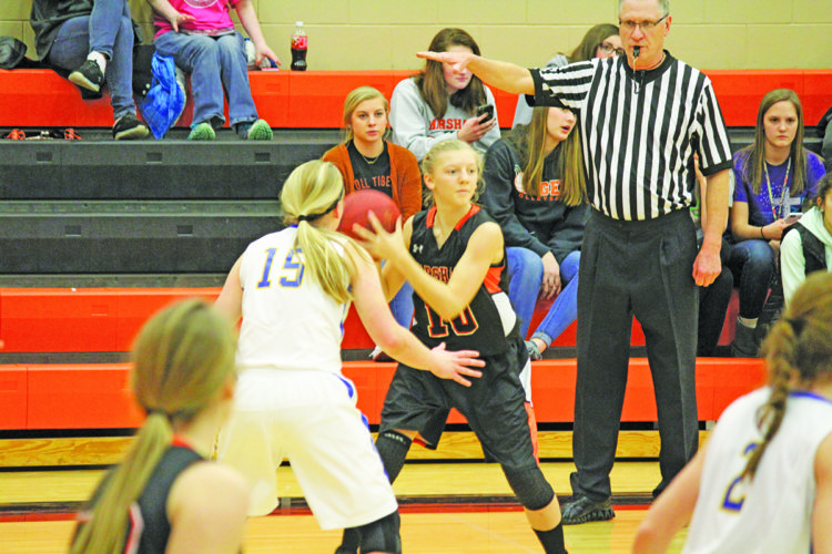 Photo by Kyla Gundvaldson  Marshall's Natalee Sample looks for a teammate against Windom Area Thursday. The Tigers won 56-18.