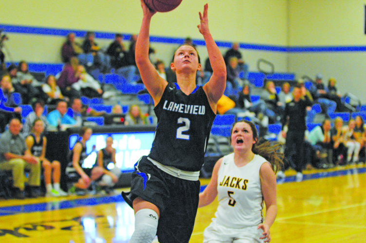 Photo by Gary Kaczmarek  Lakeview's Brooklin Peltier (2) lays the ball up against Dawson-Boyd Thursday. The Lakers won 79-59.