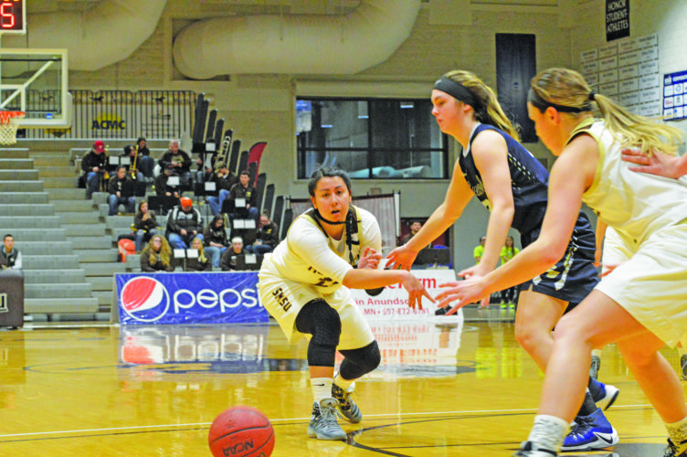 Photo by Sam Thiel  SMSU's Taylor Silva fires a bounce pass to teammate Lauren Hedlund in the first half against Concordia-St. Paul Friday.