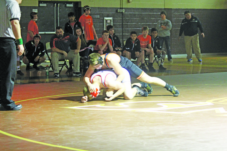 Marshall's Elijah Sterner pins a Redwood Valley opponent Friday. The Tigers won 63-11.