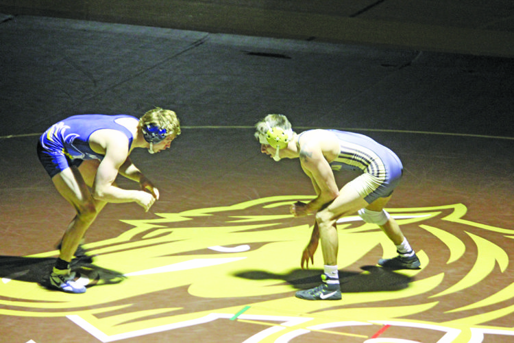 Photo by Brennen Rupp SMSU's Jordan Biehn sizes up his Augustana opponent in their match Saturday afternoon.