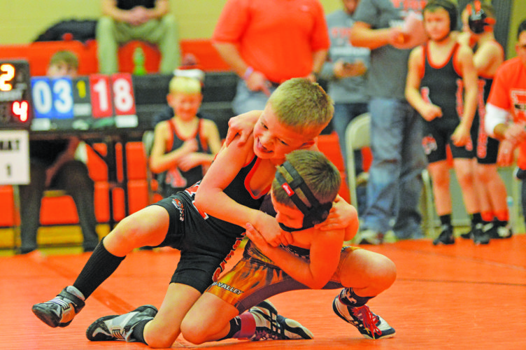 Photo by Sam Thiel Marshall's Braden Nibbe tries to bring down a Tri-Valley opponent in their match Saturday afternoon.