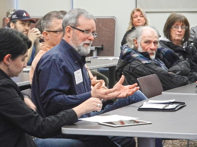 Photo by Deb Gau Ian Cunningham, of Pipestone, was one of the area farmers who spoke to members of Sen. Amy Klobuchar's staff during a public forum in Marshall on Monday. The forum was focused on gathering input for the next Farm Bill.