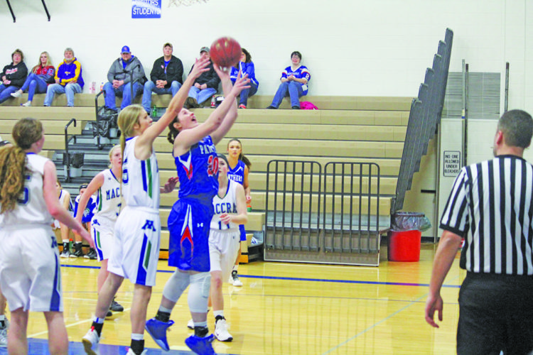 Photo by Brennen Rupp  TMB's Sydney Lanoue goes up for a layup against MACCRAY Monday. TMB won 63-56.
