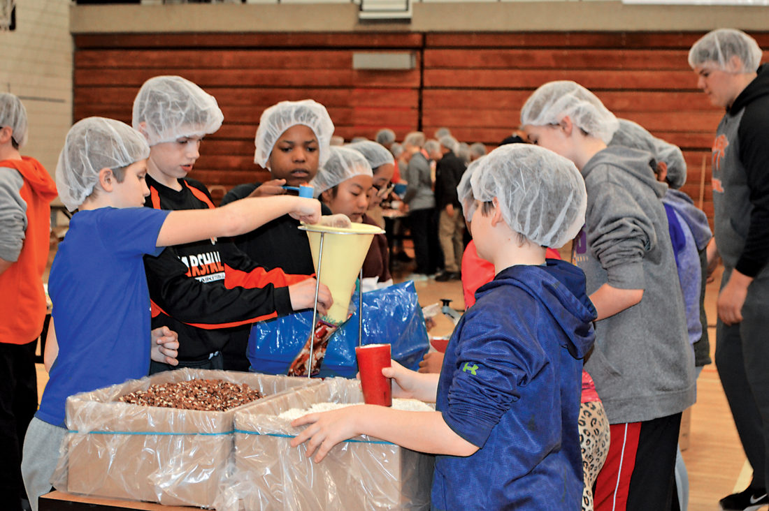 Photo by Jenny Kirk Marshall Middle School sixth-graders joined forces to package beans and rice meals as part of an annual Food for Kidz local and global hunger relief project sponsored by Marshall Sunrise Rotary Club. Approximately 95,000 meals were packaged on Friday morning.
