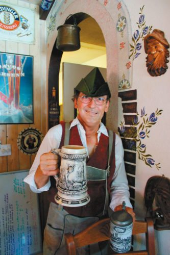 Bernard Weber, chef-owner of Brigit & Bernard's Garden Cafe in Kahului, hoists a stein of icy cold draught beer for his 18th annual Oktoberfest that he'll present each week on Fridays and Saturdays throughout the month.  CARLA TRACY photo