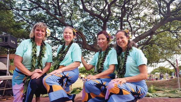 Kahului – Joyce Kawakami (from left), Kathie Mundy, Patti Keau and Michelle Ancheta danced hula on the Maui United Way Float in the Maui Fair parade last week; photo by Karen Saka.