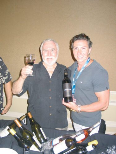 Instructor Horst Antosch (left) toasts to Tyler Olbref, founder and vintner of Nellcote Winery in Napa Valley, at the Kapalua Wine & Food Festival in June. Antosch will teach an intro course on being a sommelier on two evenings. CARLA TRACY photo