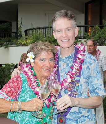 Adele Rugg and Tim Lauer toast to the Chaine des Rotisseurs at the Sheraton Maui Resort & Spa's ocean lawn recently. The Maui News / CARLA TRACY photo