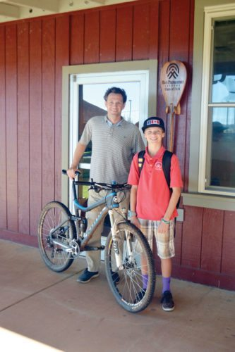 Ryan Kirkham stands with his son Jonah, 13, on Tuesday. Ryan Kirkham, principal of Maui Preparatory Academy, will be competing in the Xterra World Championship triathlon on Sunday in Kapalua. The Maui News / ROBERT COLLIAS photo