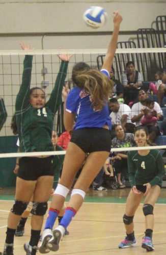 Molokai High School's Lorralyn-Shai Rawlins and Seabury Hall's Isabel Bennett meet at the net during the Farmers' five-set win over the Spartans on Thursday. ADAM BECKWITH photo