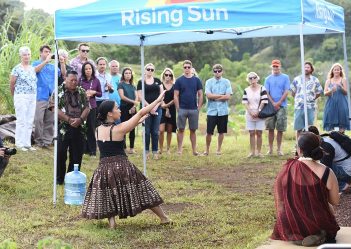 "Kamie-Lei Fujiwara of Halau Na Lei Kaumaka o Uka dances the hula ""Ke Welina"" as kumu hula Napua Greig-Nakasone provides the beat during Thursday afternoon's dedication of Maui's first solar plus storage system at the Haiku home of Kitty and Peter Walsh, parents of famed Maui surfer Ian Walsh. ""We're excited to be harvesting energy from the sun,"" said Kitty Walsh. ""I feel like a pioneer for sustainable energy on the island."" The leased system features a Tesla battery that stores electrical energy. The Maui News / MATTHEW THAYER photo"