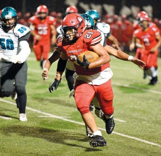 Lahainaluna High School's Donovan Defang carries the ball in the second quarter of the Lunas' 42-0 win over King Kekaulike on Friday at Sue Cooley Stadium.  The Maui News / MATTHEW THAYER photo