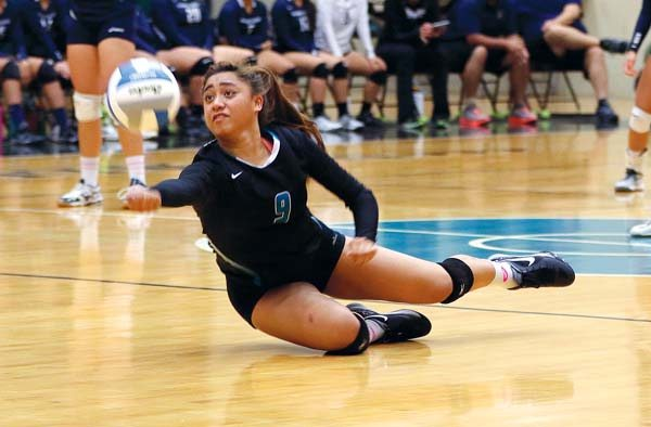 King Kekaulike High School's Kalena Vaivai dives for a ball during the final set of Na Alii's 25-14, 25-22, 19-25, 25-23 win over Kamehameha Maui on Friday in the Maui Interscholastic League Division I tournament final at King Kekaulike Gym.  The Maui News / CHRIS SUGIDONO photo