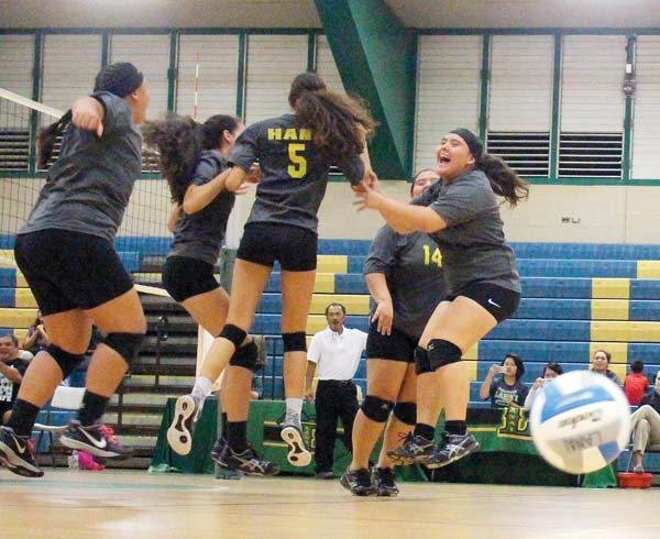 Hana High School players celebrate during their 22-25, 25-15, 25-22, 25-10 win over Molokai on Friday in the Maui Interscholastic League Division II tournament final in Lanai City.  ADAM BECKWITH photo