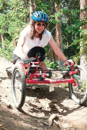 Colorado resident Sandy Lahmann has refused to let disabilities stop her from enjoying life. Here, she takes a downslope ride on a mountain bike handcycle on a trail in Keystone, Colo., around 2007.