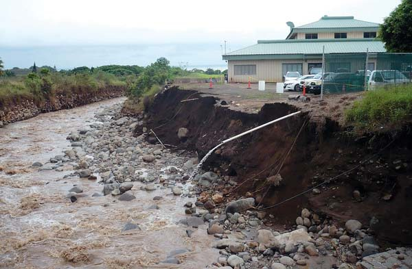 After photo of a river bank near Imi Kala Bridge and behind Maui Disposal show the damage Wailuku River flooding caused last month. A large portion of the company's parking lot collapsed in the flood that left trucks hanging over the edge.  Maui County Department of Public Works photo