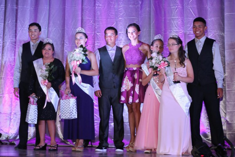 Jacob Espania (from left), Casey Gamiao, Shanyce McAvoy, Kainoa Tabaco, Lindsey Saludares, Kiele Pahia, Abby Clayton and Kainoa Davis are all smiles after the crowning ceremony of the Miss Fabulous Teen 2016 pageant at Maui High School on Sunday. Saludares, a Maui High student, organized the pageant for special needs teens as part of her senior project. The Maui News COLLEEN UECHI photo