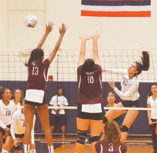 Kylee Yamashita of Kamehameha Schools Maui sends a shot past Farrington's Kohala Solomon (left) and Violet Rae Williams during the second set of the Governors' 28-26, 25-19, 25-23 victory over the Warriors on Monday in a New City Nissan Division I State Championship first-round match at Kaulaheanuiokamoku Gym. The Maui News / BRAD SHERMAN photo