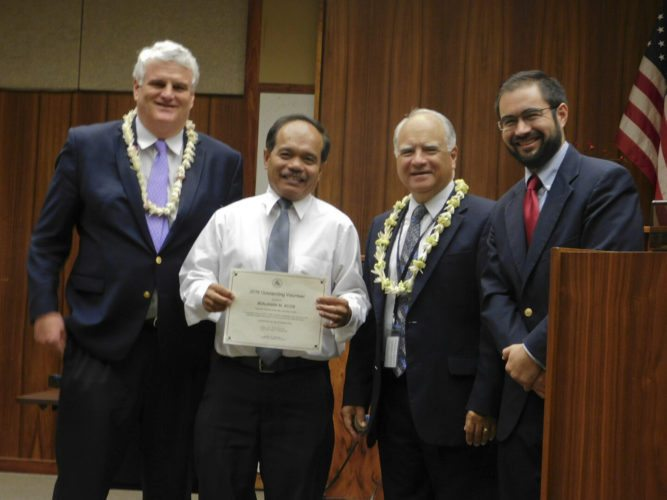 Wailuku attorney Benjamin Acob (second from left) receives the 2016 Outstanding Volunteer Award for his work at the Self Help Center at Hoapili Hale, the state Judiciary building in Wailuku. With Acob are (from left) Chief Justice Mark Recktenwald, 2nd Circuit Chief Judge Joseph Cardoza and Maui County Bar Association President Jake Lowenthal. The Maui News / LILA FUJIMOTO photo