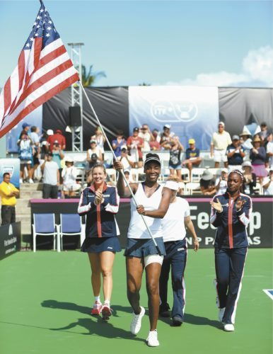Venus Williams celebrates with her U.S. teammates after a win over Poland in a Fed Cup first-round match in February at Holua Tennis Center on the Big Island. The tournament will return to the state next year, when the U.S. faces Germany at Royal Lahaina Tennis Ranch. USTA / RON ANGLE photo
