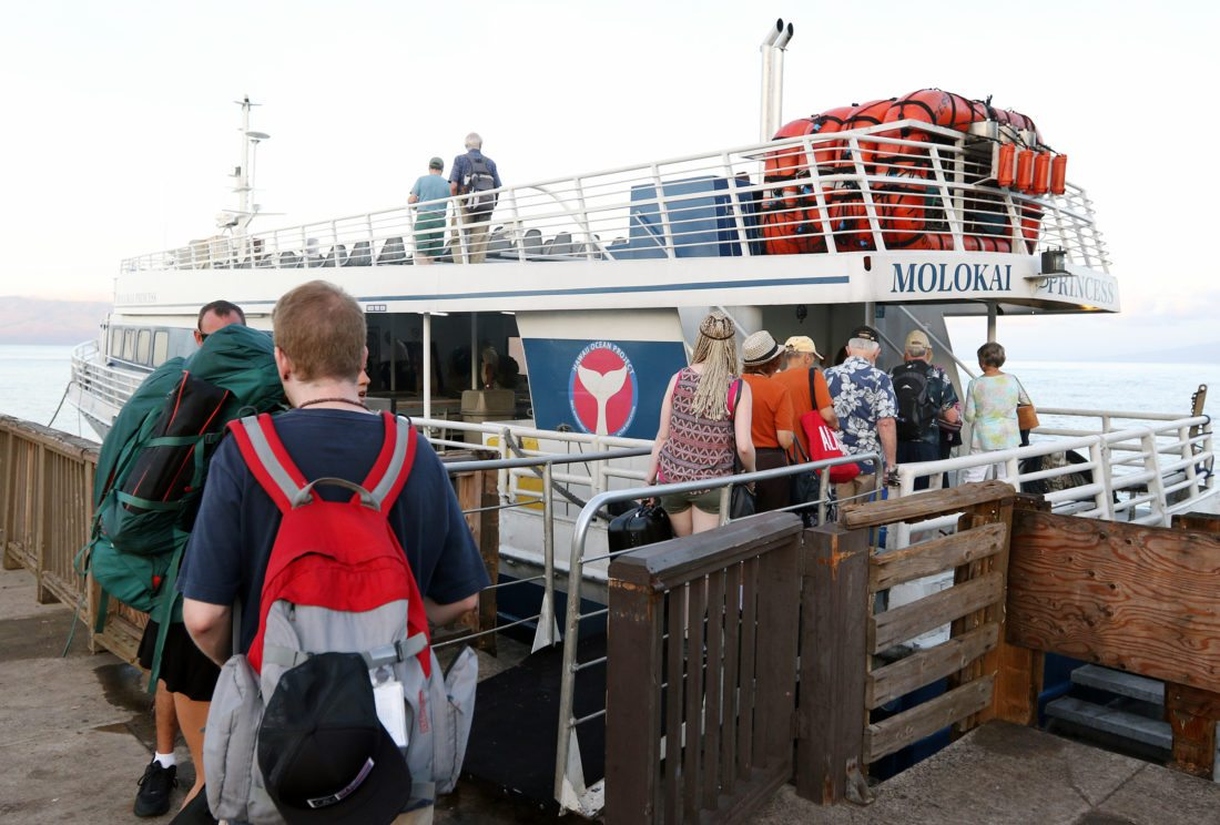 About 50 passengers board the Molokai Princess on Thursday morning for possibly the last time at Lahaina Small Boat Harbor. The Maui News / CHRIS SUGIDONO photo
