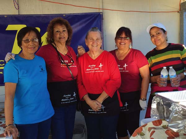Haiku – St. Rita Church parishioners Connie Munoz (from left), Laurita Ambrose, Faythe Urayanza, Robin Weeks and Angie Olaitimanthat serve teriyaki plate, Portuguese soup and Gandule rice at the sixth annual Fall Sale on Nov. 5; photo provided by Esther Yap.