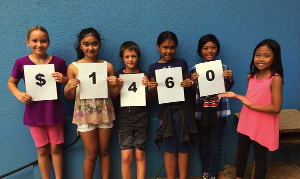 "Kihei Elementary School Student Council members display the fundraising results of their community service project ""Pennies for Polio."" They are Ginger Hill (from left), Isabella Romero, Hunter Davis, Ava Arai, Jon Calibuso and Cliana Yago."