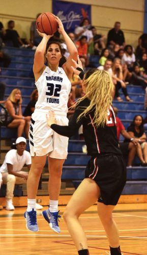 BYU's Kalani Purcell shoots over UNLV's Katie Powell in the first quarter of their Maui Jim Maui Classic game at War Memorial Gym on Friday evening.  The Maui News / MATTHEW THAYER photo
