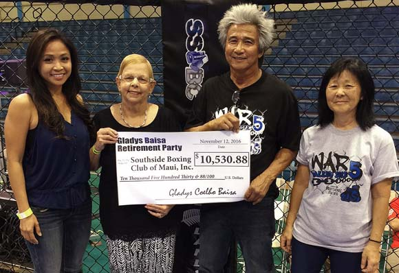 County Council Member Gladys Baisa (second from left) is shown with Sharon Zalsos (from left), who chaired Baisa's retirement party in September; Nante Manangan, founder of the Southside Boxing Club of Maui Inc.; and Dawn Manangan during the check presentation from Baisa to the boxing club on Nov. 12.  KEITH REGAN photo