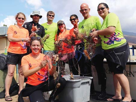 Team members from all departments at Maui Ocean Center join together to remove plastics, fishing gear and marine debris from Maui's pali coastline.  Maui Ocean Center photo